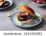 vegan burger with white bean... | Shutterstock . vector #1311421091