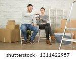 loving couple sitting on the... | Shutterstock . vector #1311422957