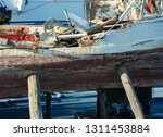 an old neglected fishing boat...   Shutterstock . vector #1311453884