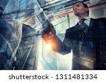 handshaking business person in... | Shutterstock . vector #1311481334