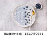 top view of blue yogurt... | Shutterstock . vector #1311490361