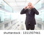 business man covering his ears... | Shutterstock . vector #1311507461