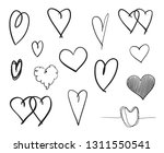 hand drawn grunge hearts on... | Shutterstock .eps vector #1311550541