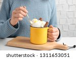 Woman Eating Snow Ice Cream At...