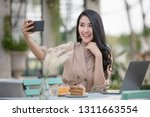 young women freelance designer... | Shutterstock . vector #1311663554