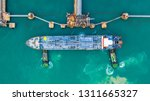 fuel tanker ship loading in... | Shutterstock . vector #1311665327