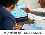 financial managers pointing at... | Shutterstock . vector #1311733301