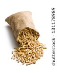 wooden pellets in jute sack on white background - stock photo