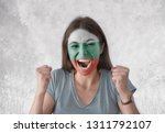 young woman with painted flag...   Shutterstock . vector #1311792107