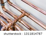 copper pipes and fittings for... | Shutterstock . vector #1311814787