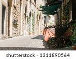 italian cafe overlooking old...   Shutterstock . vector #1311890564