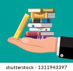 pile of books in hand. reading... | Shutterstock .eps vector #1311943397