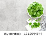 fresh spinach leaves on white... | Shutterstock . vector #1312044944