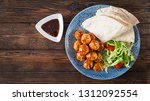 meatballs in sweet and sour... | Shutterstock . vector #1312092554