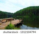 wooden pier lake mountain... | Shutterstock . vector #1312104794