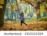 girl playing with autumn leaves. | Shutterstock . vector #1312121324