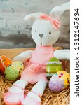 easter rabbit and eggs with... | Shutterstock . vector #1312147634