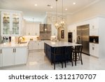 Stock photo beautiful luxury home kitchen with white cabinets 1312170707