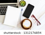 blank white paper note book... | Shutterstock . vector #1312176854