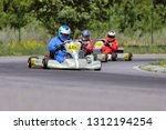 young go cart racer on circuit | Shutterstock . vector #1312194254