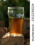 a pint of ale or beer  brown in ... | Shutterstock . vector #1312230224