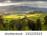 Aerial view to fields of San Miguel island under heavy rain and sun simultaneously, Azores, Portugal - stock photo
