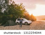 woman taking picture of sunrise ... | Shutterstock . vector #1312254044