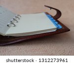 open organizer with blank pages ... | Shutterstock . vector #1312273961