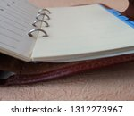 open organizer with blank pages ... | Shutterstock . vector #1312273967