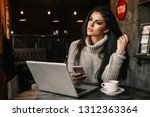beautiful woman working with... | Shutterstock . vector #1312363364