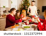 friends celebrating christmas... | Shutterstock . vector #1312372994