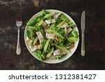 salad with herring and lemon... | Shutterstock . vector #1312381427