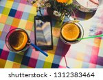 two glasses of juice and a... | Shutterstock . vector #1312383464