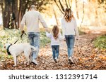Stock photo happy beautiful family with dog labrador is having fun together walking the in park 1312391714