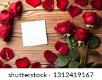 red roses with white paper on... | Shutterstock . vector #1312419167