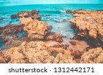 sea waves hitting rocks on the... | Shutterstock . vector #1312442171