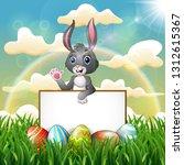 cartoon bunny holding blank... | Shutterstock .eps vector #1312615367
