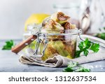 canned artichokes in olive oil  ... | Shutterstock . vector #1312637534