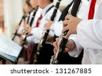 The Pupils Playing The Clarinet.