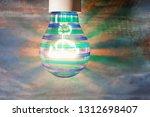 glowing light bulb on wooden... | Shutterstock . vector #1312698407