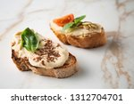 fresh tasty bruschettas on... | Shutterstock . vector #1312704701