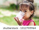 cute asian child girl drinking... | Shutterstock . vector #1312705964