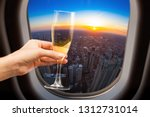 glass of wine and chicago view... | Shutterstock . vector #1312731014