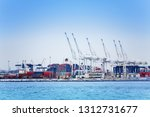 marine cranes and containers at ... | Shutterstock . vector #1312731677