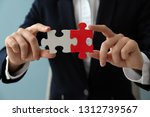 woman with pieces of puzzle on... | Shutterstock . vector #1312739567