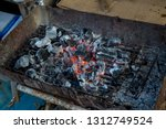 stove charcoal.orange flames of ... | Shutterstock . vector #1312749524