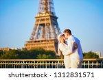romantic couple having a date... | Shutterstock . vector #1312831571