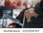 hands pushing disabled older... | Shutterstock . vector #1312926767