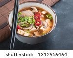 asian spicy soup with tofu and... | Shutterstock . vector #1312956464