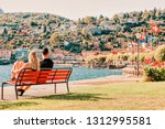 romantic young couple sitting... | Shutterstock . vector #1312995581